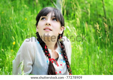 Pretty girl relaxing outdoor - stock photo