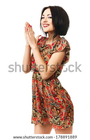 Pretty girl rubbing her hands in anticipation of something, isolated on a white background