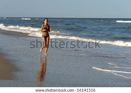 Pretty girl running on the beach