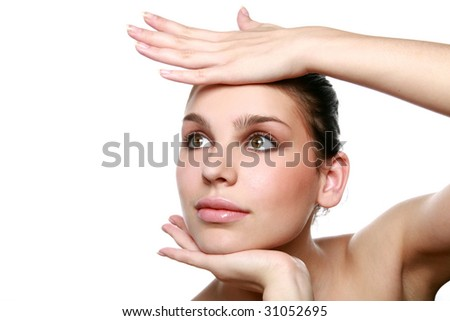 Pretty girl's portrait with hands isolated on white - stock photo