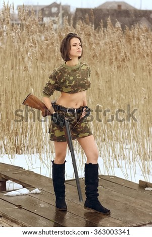 pretty girl shooting from hunting rifle