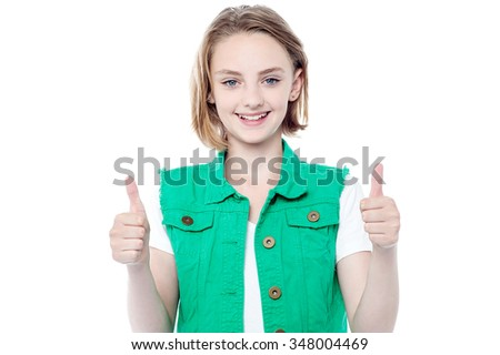 Pretty girl showing double thumbs up - stock photo