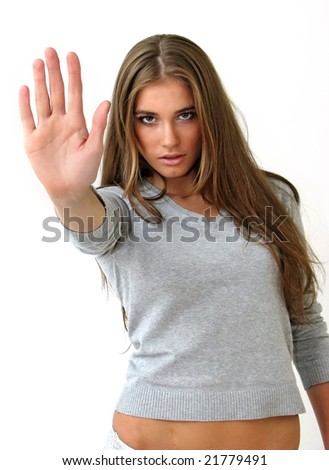 "Pretty girl showing ""Stop!"" gesture with her hand. - stock photo"