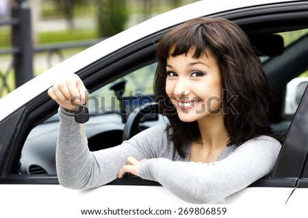 Pretty girl showing the car key - stock photo