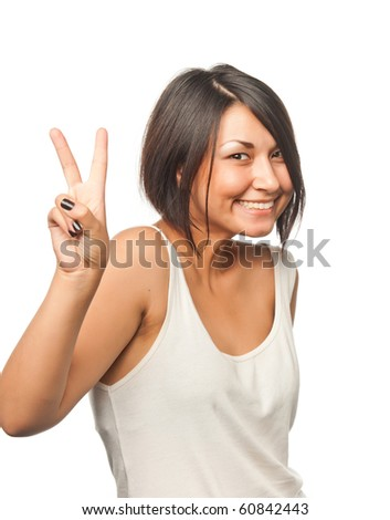 Pretty girl shows a victory sign - stock photo