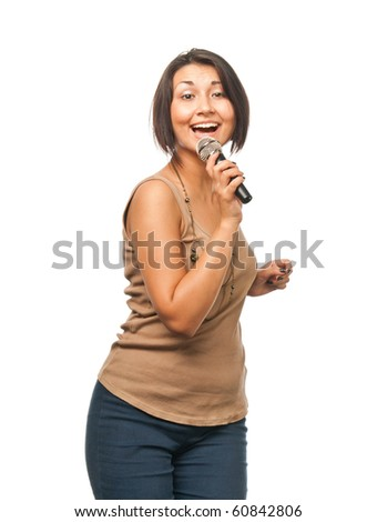 Pretty girl singing into a microphone - stock photo