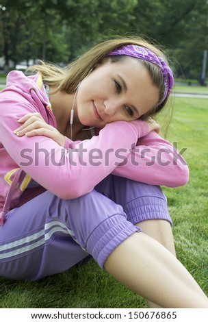Pretty girl sitting on the grass