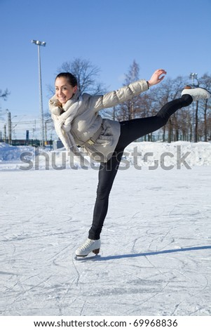 Pretty girl skating - stock photo