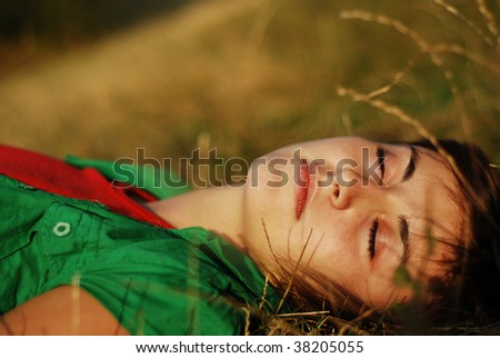 pretty girl sleeping outdoors - stock photo