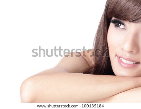 pretty girl smile face and look to blank copy space , model is a asian woman