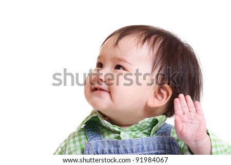 Pretty girl smiling and waving - stock photo