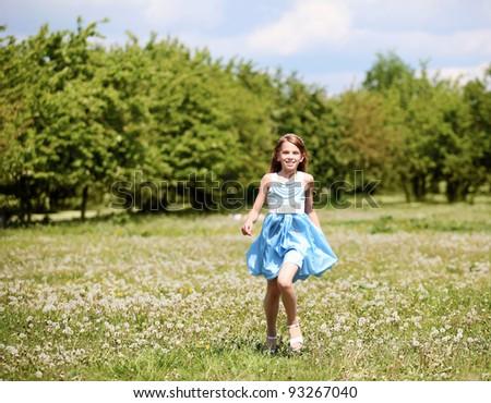 pretty girl  spending time in the summer park - stock photo