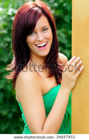 Pretty Girl Standing Outside In The Summer Sun - stock photo