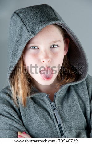 pretty girl sticking out tongue - stock photo
