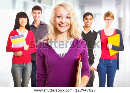 Pretty girl student and her diversity friends on background