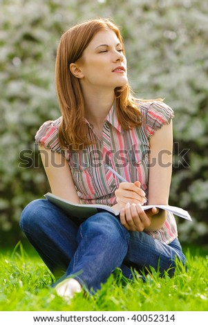 Pretty girl studying outdoors