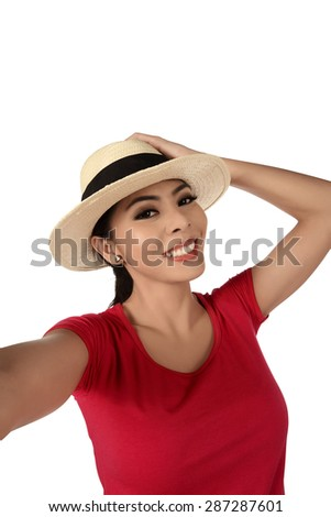 Pretty girl take a selfie portrait isolated over white background - stock photo