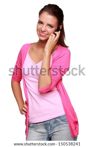 Pretty girl talking on a mobile phone/Charming young woman listens to music through headphones - stock photo