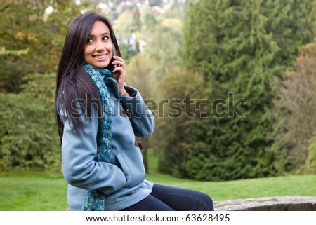 Pretty girl talking on her cellphone - stock photo