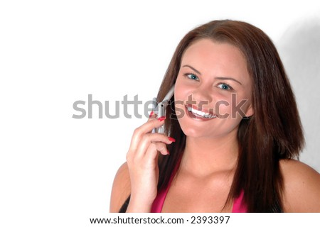 Pretty girl talking on phone (copy space to the left)