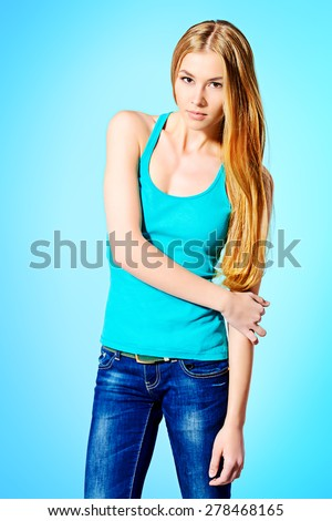 Pretty girl teenager with long hair and beautiful smile expressing happiness. Hair care, healthy hair. Healthy teeth. - stock photo