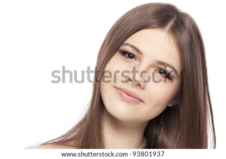 Pretty girl teenager with long straight brown glossy hair clean skin looking at camera, isolated on white background in studio closeup - stock photo