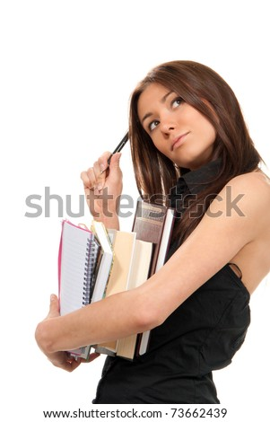 Pretty girl thinking, holding stack of books, notebook, copy-book and a pen near the head  ready for college classes on a white background - stock photo