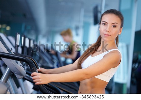 pretty girl training at the gym