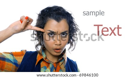 Pretty girl twists her finger to her temple - stock photo