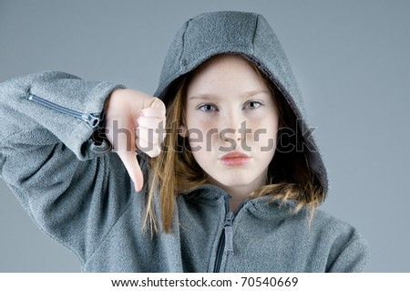 pretty girl voting no with thumb - stock photo