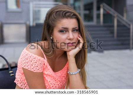 Pretty girl waiting for Her date. He is late. - stock photo