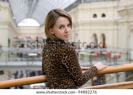 Pretty girl walking in a shop - stock photo