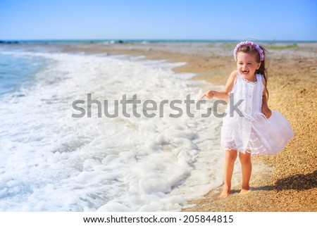 pretty girl walking on the beach, waves, wind, rest, happiness - stock photo