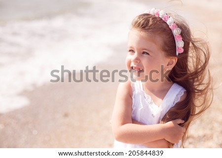 pretty girl walking on the beach, waves, wind, rest, happiness