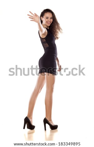 pretty girl walking on white background and waving her hand - stock photo