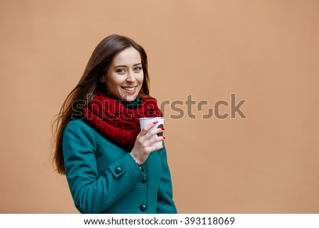 pretty girl walking with a cup of coffee