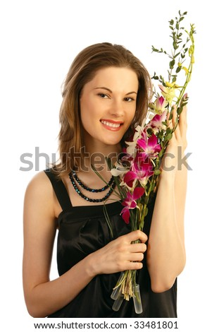 Pretty girl with a bouquet. Isolated on white