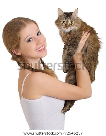 pretty girl with a fluffy cat on a white background - stock photo