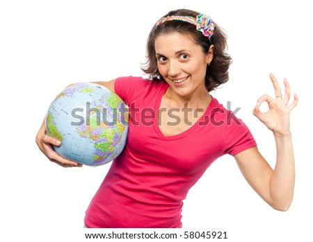 Pretty girl with a globe ball - stock photo