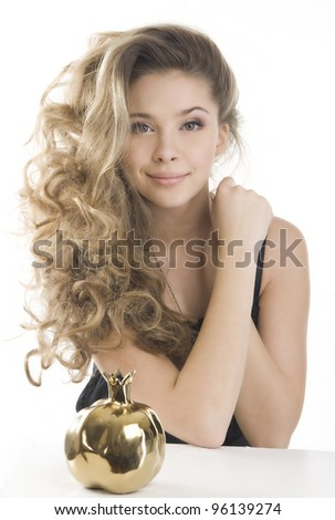 Pretty girl with a golden pomegranate - stock photo