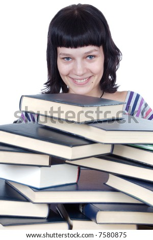Pretty girl with a mess pile of books - stock photo