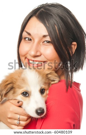 Pretty girl with a puppy