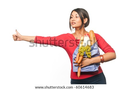 Pretty girl with a shopping bag catches a taxi - stock photo