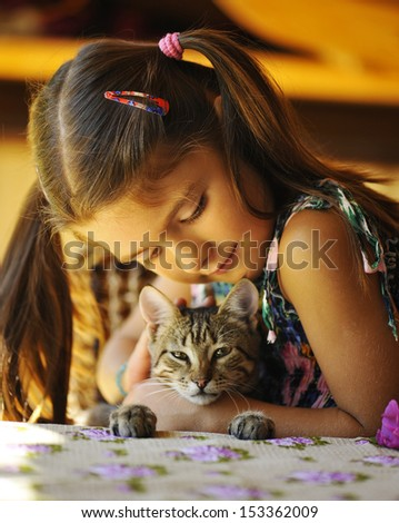 Pretty girl with a striped kitten - stock photo