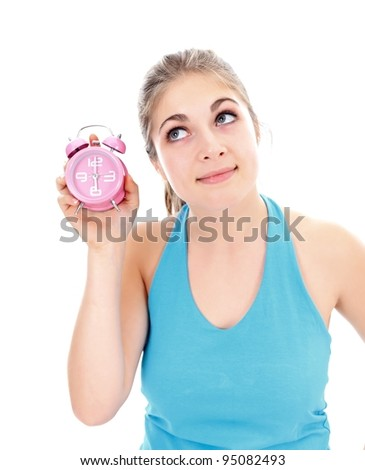Pretty girl with an alarm clock in her hand, concept - stock photo
