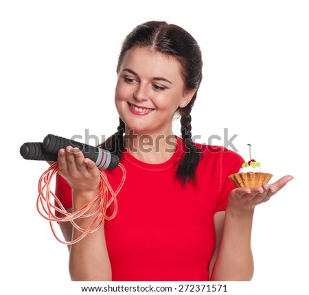 Pretty girl with cake and skipping rope isolated on white background - stock photo