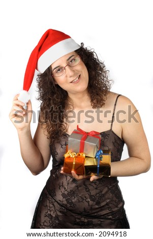 Pretty girl with christmas hat, holding gifts boxes