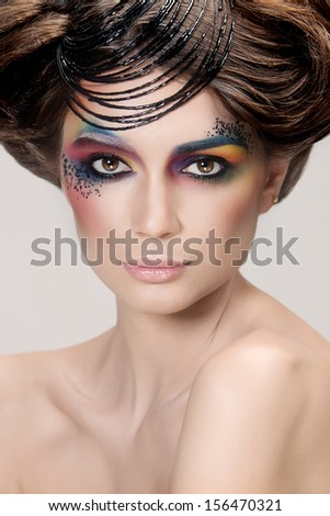 Pretty girl with colorful make-up