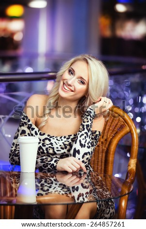 Pretty girl with cup of coffee or tea - stock photo