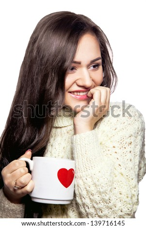 Pretty girl with cup of tea on white background in studio - stock photo